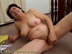 Hairy old pussy fucked by a banana