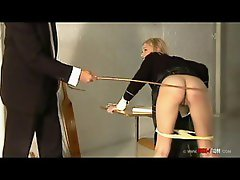 Naughty schoolgirl is caned and spanked