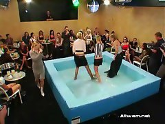 Two gals wrestling impressively in sticky oil