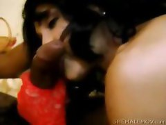 Tranny in gloves giving a blowjob