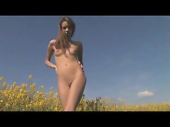 Teen naked amongst the flowers