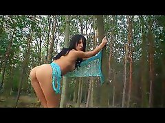 Naked teen walking in the forest