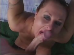 Horny milf stroking and sucking on a huge dong