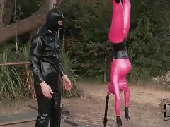 Head to toe latex girl bound and hung upside down