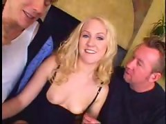 Blonde gobbles two dicks and they have anal sex