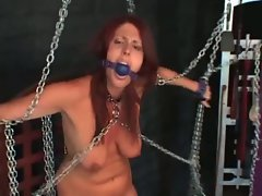 Chained and gagged girl in the dungeon