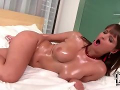 Oiled up brunette hottie with huge jugs slides dildo in her pussy