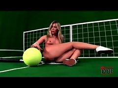 Perky blonde teen showing off her curves with a huge tennis racket