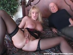 Milf in stockings sucks on cock