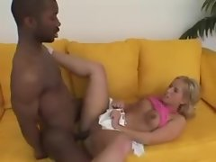 Tiny blonde babe rides her lovers huge black cock