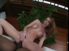 Busty redhead milf enjoys getting her ass slammed
