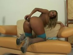 Perfectly bronzed blonde babe with gorgeous ass using toys