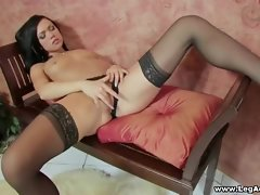 Mouth watering brunette babe in hot stockings rubs pussy