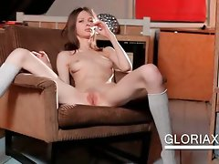 Nude Gloria touches gaunt pussy on a chair