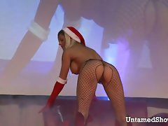 Sensual blond with filthy body dancing on the stage
