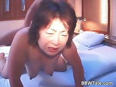 Older buxom asian girl with enormous melons part4
