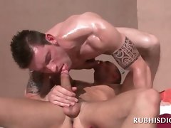 Alluring masseur gives gay dick sucking