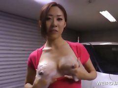Asian sweety washes a car with her knockers