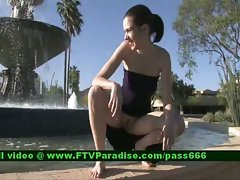 Isobel teenage redhead slutty girl outside in a fountain with her babefriend