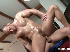 Sexual gay masseur rides large penis