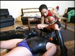 Lewd femdom playing with her slaves
