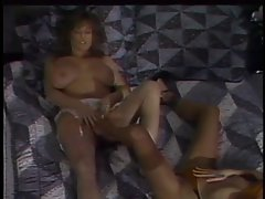 Wench with big melons getting a foot rub on her cunt