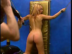 Tempting blonde with sweet naturals admiring a BDSM session