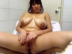 Chesty Latina masturbates in bathroom